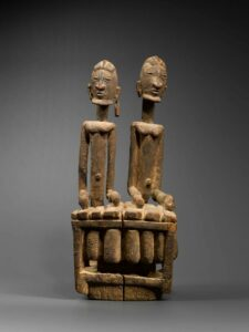 Ancient balafon sculpture with two players